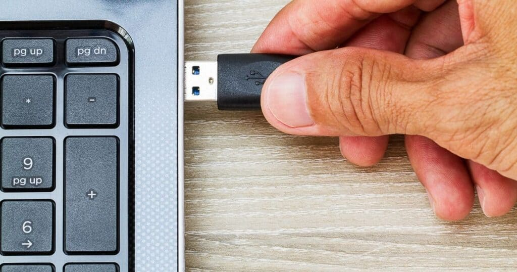 usb device being plugged into a laptop