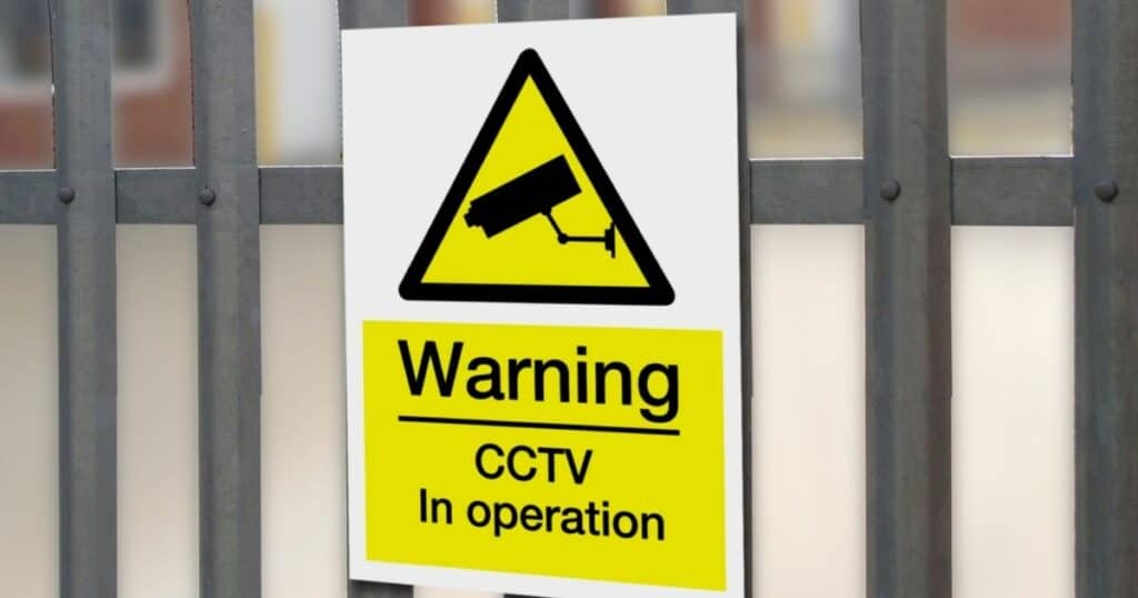 CCTv in operation - yellow signage